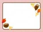 ドングリと落ち葉のチェックフレーム飾り枠イラスト