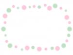 緑とピンク色のふんわり水玉のフレーム飾り枠イラスト