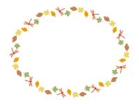 秋・赤とんぼと落ち葉の楕円フレーム飾り枠イラスト