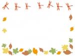 秋・落ち葉の上を飛ぶ赤とんぼのフレーム飾り枠イラスト